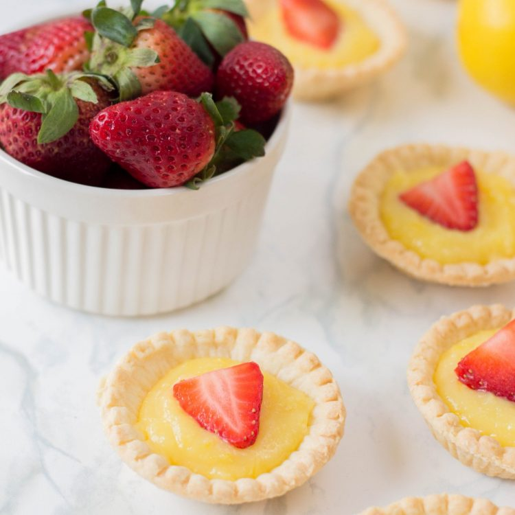 The perfect summer dessert recipe! Looking for a strawberry recipe to make with your summer berries? This one with have your mouth watering-- It's a Strawberry Lemon Tarts Recipe that is family friendly and delicious! Perfect for tea parties and summer desserts! #Strawberries #Baking #StrawberryRecipe #Recipes #Tarts #Pie #Homemade #StrawberryTart #StrawberryPie