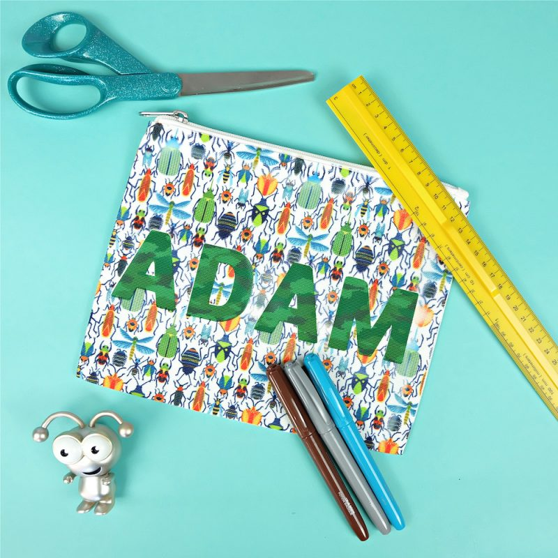Send your kids back to school in style with a super fun 10 minute DIY project! This Cricut Infusible Ink Pencil Pouch is so easy to make! Customize it with your child's favorite pattern of Infusible Ink and their name for a handmade back to school supply they'll love! #Cricut #InfusibleInk #BackToSchool #DIYBackToSchool #PencilPouch #handmade #DIYSchoolSupplies #CricutMade #CricutCreated #CricutCrafts