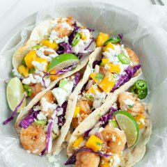 What's for dinner? This homemade shrimp tacos recipe with mango salsa is fresh, healthy and delicious! This easy 30 minute dinner meal idea is made with whole foods and delicious flavors that the entire family will love! #Tacos #Shrimp #mango #recipe #summer #cilantro #30minutemeal #homemade #Easy #mealplanning