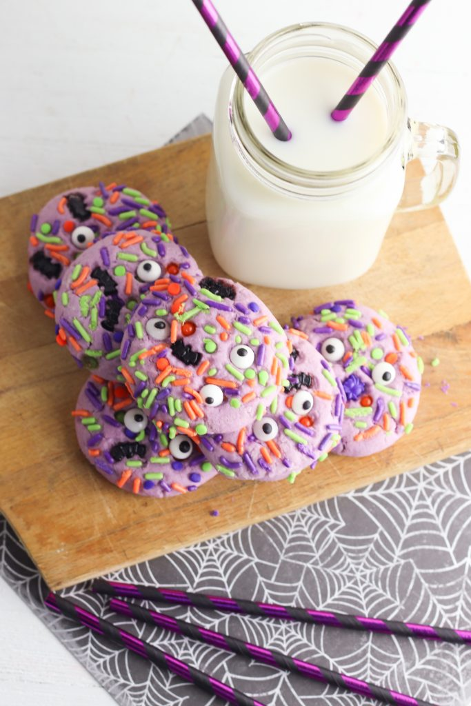 They're creepy and they're kookie, they're all together spooky! Grab this easy Monster Mash Halloween Sugar Cookie Recipe for baking with kids! Perfect for family Halloween fun and classroom Halloween party snack ideas! #Recipe #cookies #Halloween #Monster #PurpleFood #FamilyFriendly #CookingWithKids #Homemade