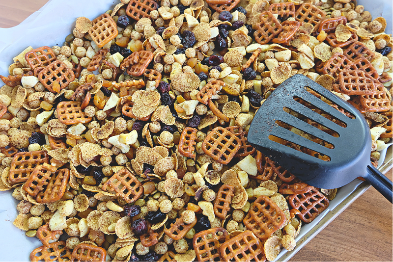 This delicious pumpkin spice fall snack mix recipe is the perfect snack for kids (and adults) looking for a healthy snack. Vegan and nut free, this cereal trail mix recipe is school safe and is a perfect classroom halloween party snack idea! #snack #Recipe #SnackIdea #trailmix #snackmix #cerealmix #cerealrecipe #halloween #fall #autumn #pumpkinspice #homemade #kidfriendly #kidscooking #kidsbaking #snackmix