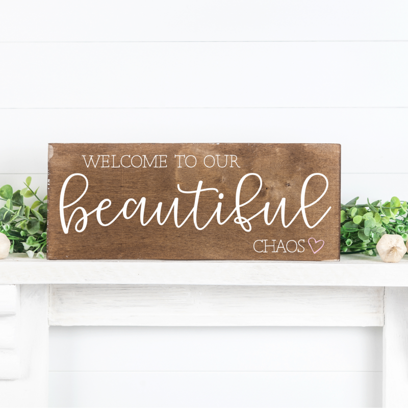 Make beautiful handmade gifts for family and housewarming with this Welcome To Our Beautiful Chaos cut file! Also includes 15 free family themed SVG files from your favorite craft bloggers. Use these cut files with your Cricut Maker, Cricut Explore, Silhouette Cameo or other electronic cutting machines to make beautiful family signs and more. #Crafts #handmadegifts #DIY #FamilySign #Family #SVGFiles #CricutCreated #CricutMade #CutFiles #FreeCutFiles #FreeSVG #farmhousedecor