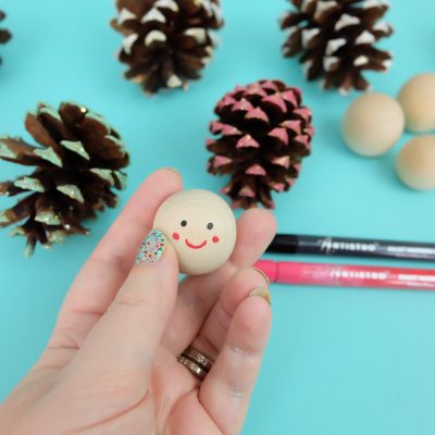 Easy step by step instructions for making DIY Pinecone Ornament that look like gnomes. A fun and adorable pinecone craft for Christmas.