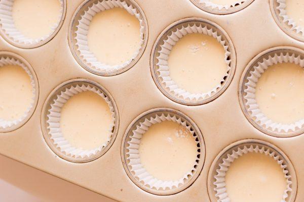 Cupcake batter in a muffin tin.