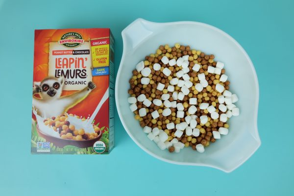 Leapin Lemurs cereal next to a bowl filled with cereal and marshmallows for making snack mix.