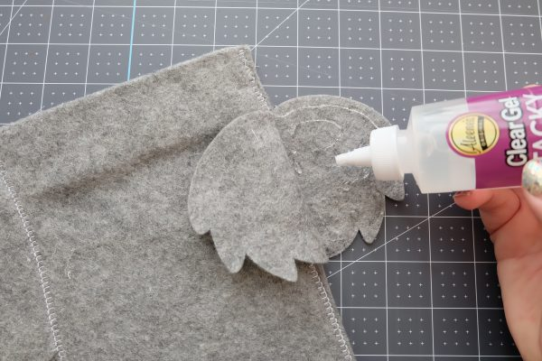Use fabric glue to glue the ears of your stocking.