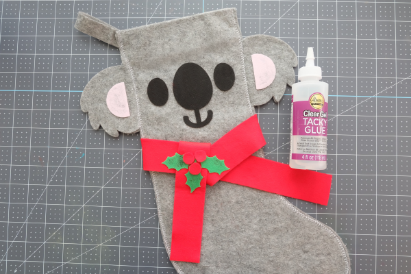 Add a cute decorative scarf and holly to your koala stocking.