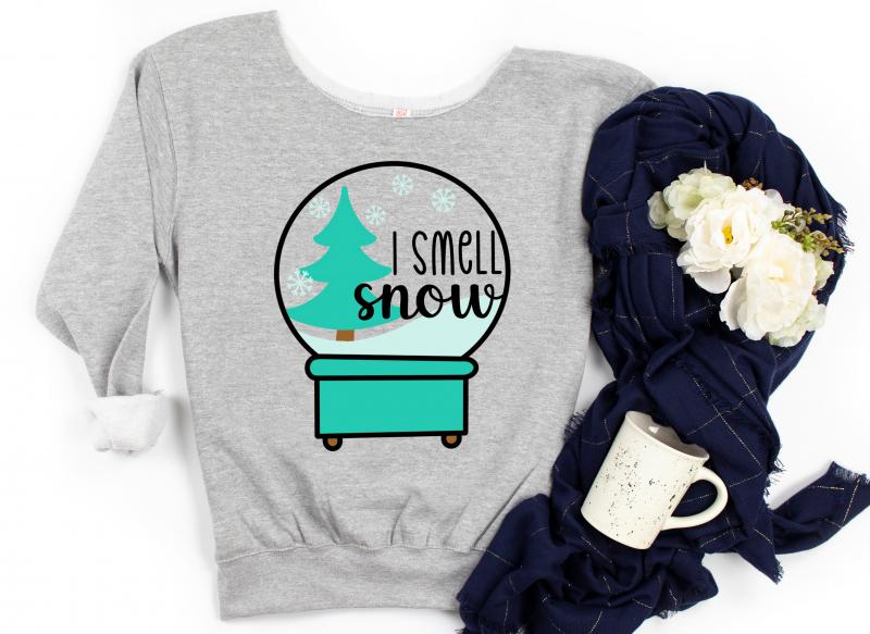 I Smell Snow Snow Globe Sweatshirt with a mug and scarf.