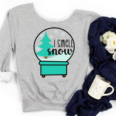 Download a free I Smell Snow Snow Globe SVG that's perfect for winter crafting along with 15 free snow cut files that you can cut with your Cricut, Silhouette or other electronic cutting machine.