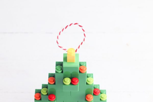 Create a loop with a piece of string and glue it to the back of the Christmas tree to hang.
