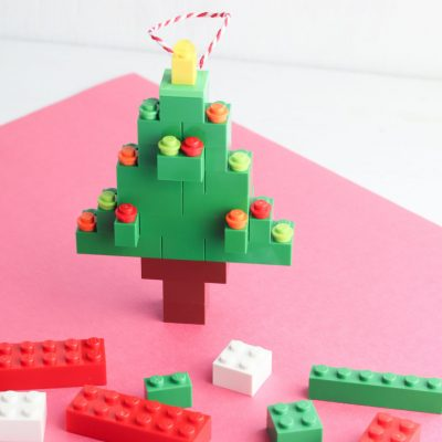 In this adorable kids craft project, you'll learn how to make a DIY Lego Christmas Tree Ornament! With step-by-step instructions and photos this is an easy Christmas craft your whole family will have fun with! #ChristmasCraft #ChristmasOrnament #ornament #lego #LegoChristmas #KidsCraft
