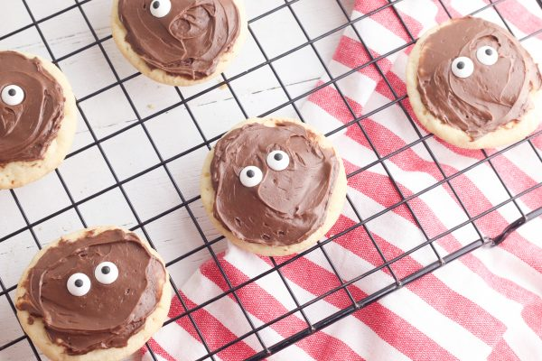 Place two candy eyes in the center of the cookie.