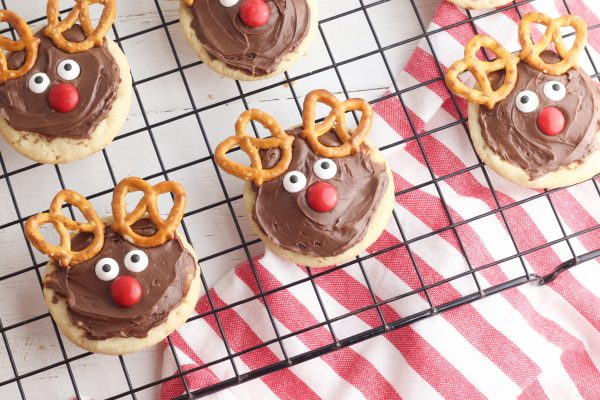Place two mini pretzels at the top of the cookies to form the reindeer's antlers.