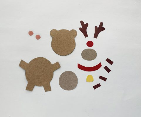Trace the patterns from the provided template onto different colors of construction paper then cut them out.