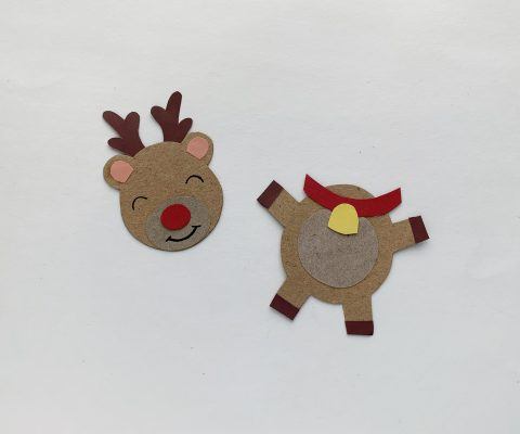 Use a black sharpie to draw the eyes and mouth onto the reindeer. Attach the collar piece near the top side of the body pattern.