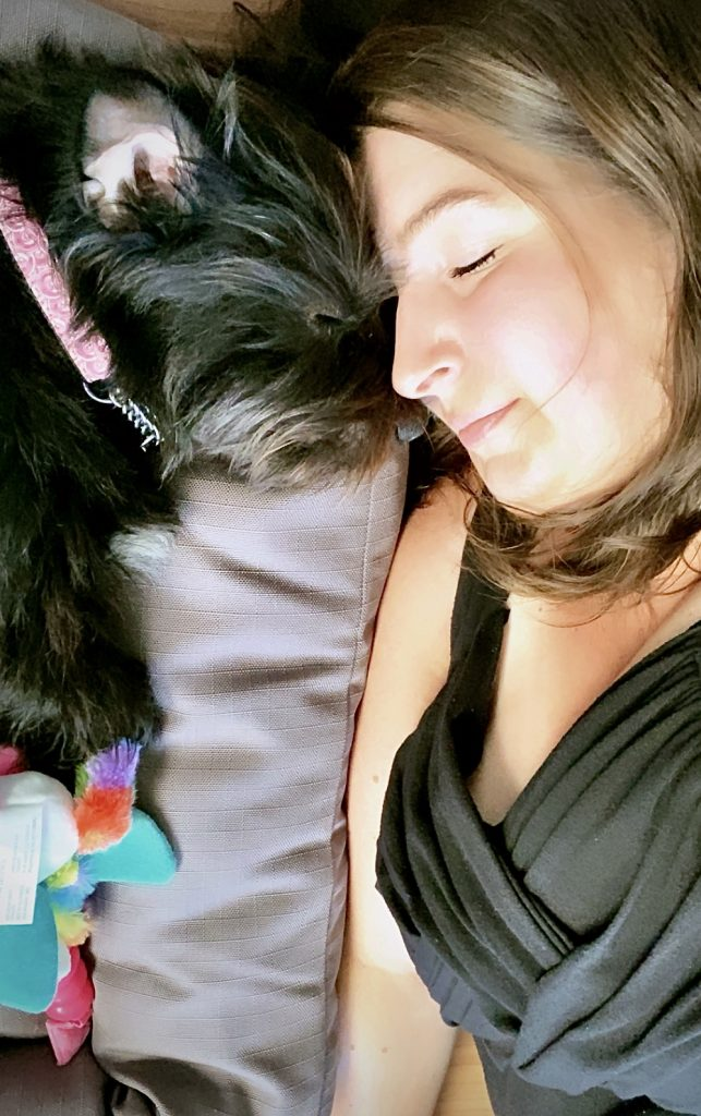 Rescue dog cuddling nose to nose with his adopter.