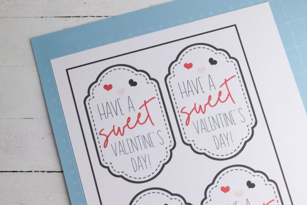 Hit the make it button and select your printer. Print the cards on cardstock. Place the printed cards on your cutting mat and load the paper into the Cricut.