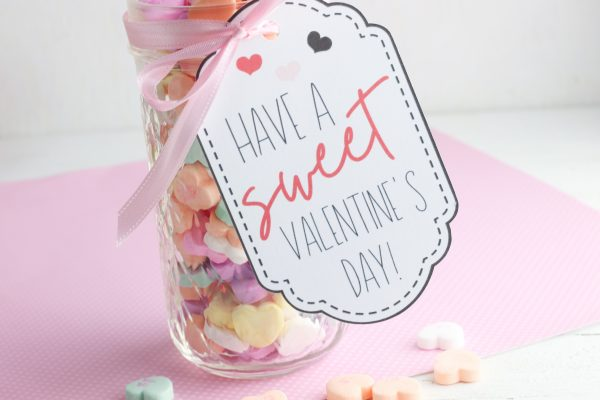 Tie the card to the top of the jar. Fill the jar with candy.