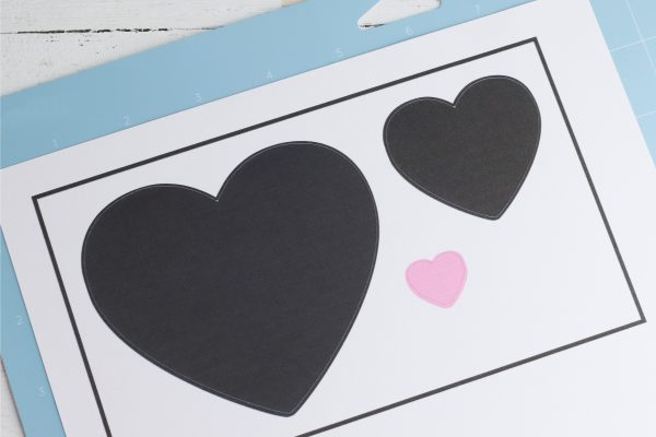 Send the design to your printer, then place the printout on the cutting mat and load into the Cricut. Cut the design and remove it from the cutting mat.