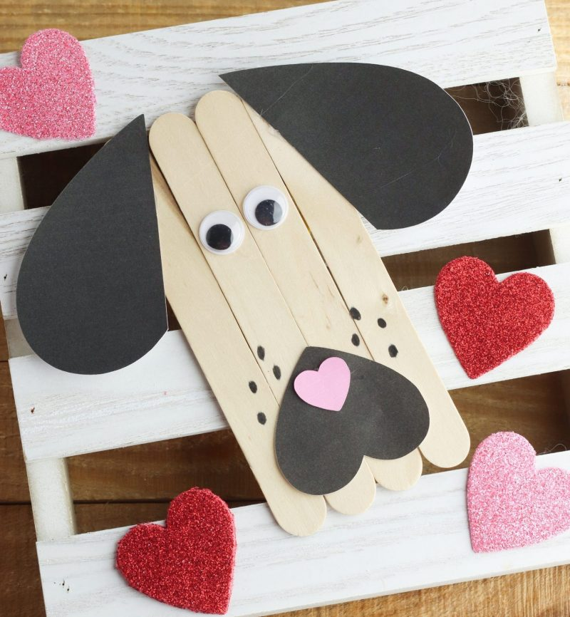 We love rescue dogs! This Puppy Love Valentine Popsicle Stick Craft is just for them! Great for an easy preschool craft (or kindergarten and early primary school) for Valentine's Day or anytime they want to show a bit of puppy love. #KidsCrafts #PopsicleStick #CraftStick #ValentineCrafts #PreK #Preschool #PreschoolCrafts #PreKCrafts #RescueDogs