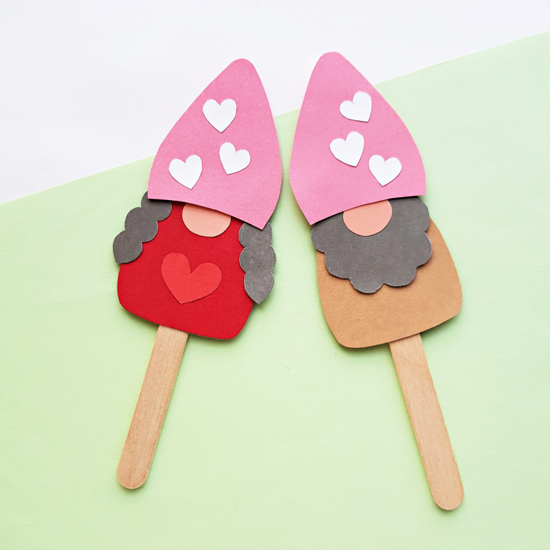 Are you as crazy for adorable gnomes as we are? This Popsicle Stick Kids Craft is so cute! Make DIY Gnome Puppets! Switch up the colors and embellishment on the gnome to change it from a Valentine Craft, to a St. Patrick's Day Craft to a Christmas craft and more! Comes with a free printable template.
