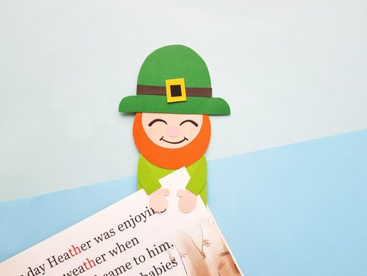 Slide the page of your book under the leprechauns arms to mark your page!