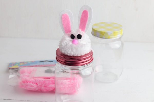 Glue the bunny head to the top of the jar lid.
