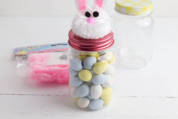 Fill the jar with candy.