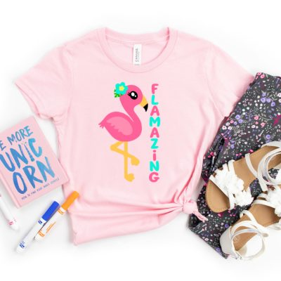 Make the cutest DIY kids shirt ever with this free Flamazing Flamingo Cut File! We're also sharing links to 14 free Flamingo SVGs that you won't want to miss! Perfect for making DIY summer party decorations, shirts, mugs, beach totes and more with your Cricut or other electronic cutting machine!