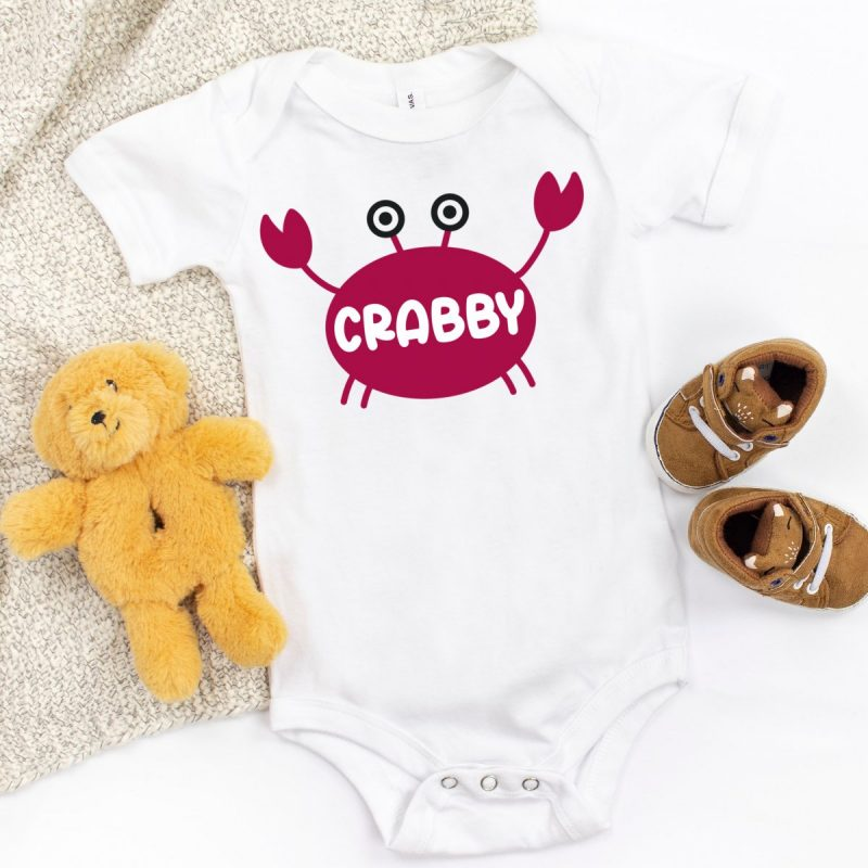 Onesie with a red crab that says crabby across its shell.