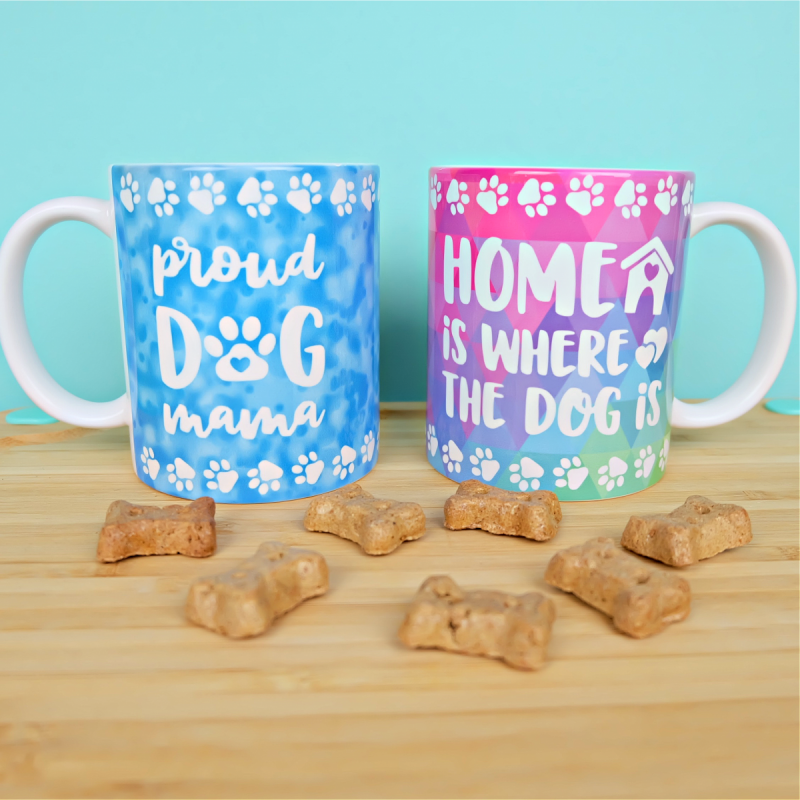 Download 13 free wrapped mug svgs that are perfect for using with the Cricut Mug Press! From dog themed mugs, to funny mugs, to crafty mugs we've got you covered with a ton of adorable designs! Cut using your Cricut Maker, Cricut Explore Air 2 or Cricut Joy! They make great handmade gifts. Includes a two side cut file that says Proud Dog Mama on one side and Home Is Where The Dog is on the other.