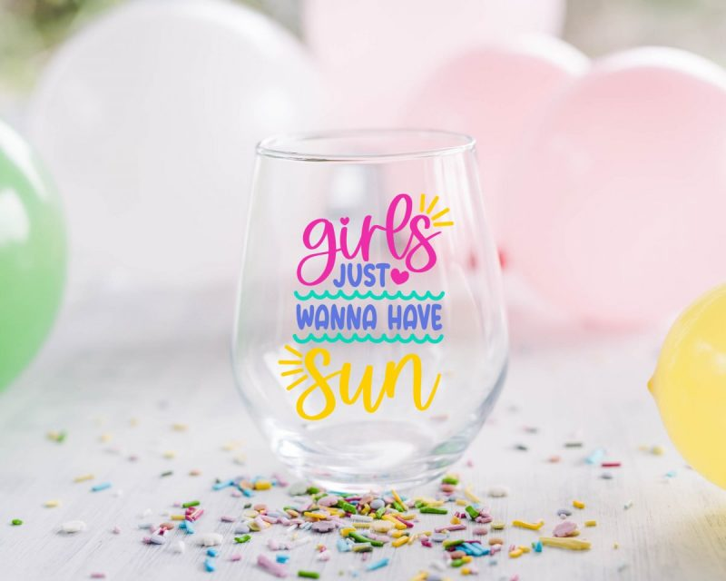 Wine glass that says Girls Just Wanna Have Fun in colorful letters