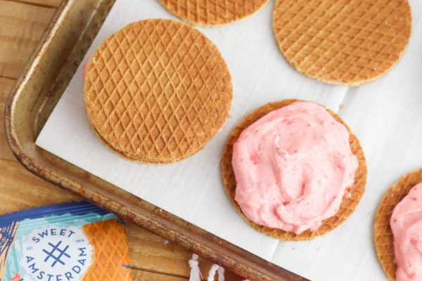 Lay 12 Lemon Bar Stroopwafels on a baking sheet. Spread the softened ice cream over the top of each of the cookies. Place remaining cookies on top of the ice cream to form a sandwich.