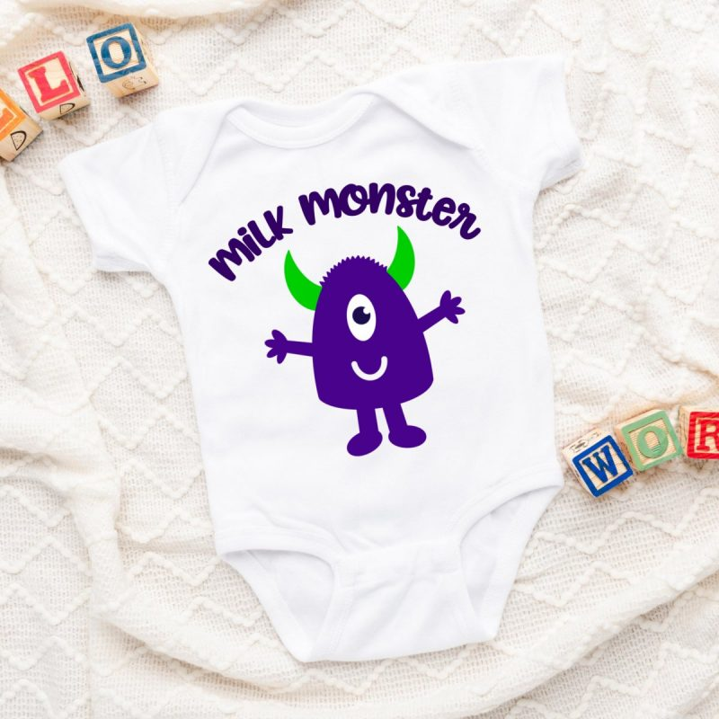 Onesie laying on a baby blanket with an adorable purple monster with green horns. The words Milk Monster are curved above.
