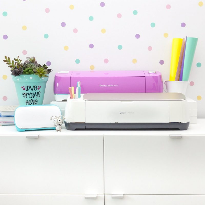 Cricut cutting machines sitting on counter in craft room.
