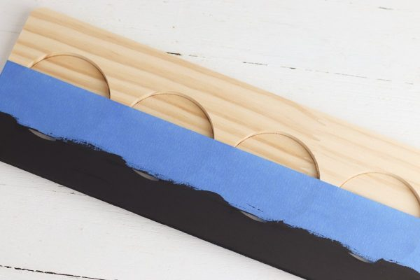 Paint your flight board using chalkboard paint. Allow to dry completely, then remove the tape.