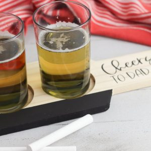 Place the small glasses on the board and use the chalk to write the type of beer in each glass.