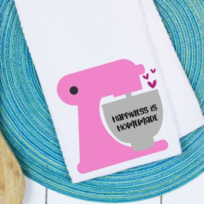 Spread a bit of happiness with our free Happiness Is Homemade SVG File. This kitchen themed cut file is perfect for making handmade gifts including DIY dish towels, mugs, shirts and more using your Cricut or other electronic cutting machine!