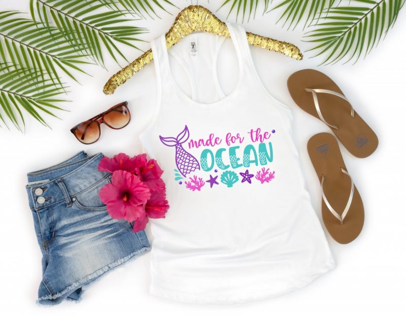 If the beach is your happy place, then this free cut file is for you! Make DIY tank tops, onesies, mugs, beach bags and more with this Made For The Ocean Mermaid SVG File! Get your craft on with your Cricut, Silhouette or other electronic cutting machine. So much fun for mermaid birthday parties or mermaid lovers with summer birthdays!
