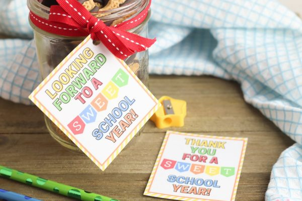 Use a hole punch to punch a hole in the corner of the tag. Package the sweet treat in a jar or bag, if needed, then thread the ribbon through the hole on the gift tag. Attach the tag to the gift with a bow.